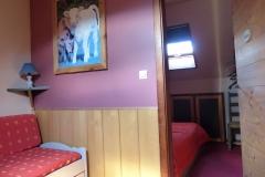 Le petit salon détente et la troisième chambre double